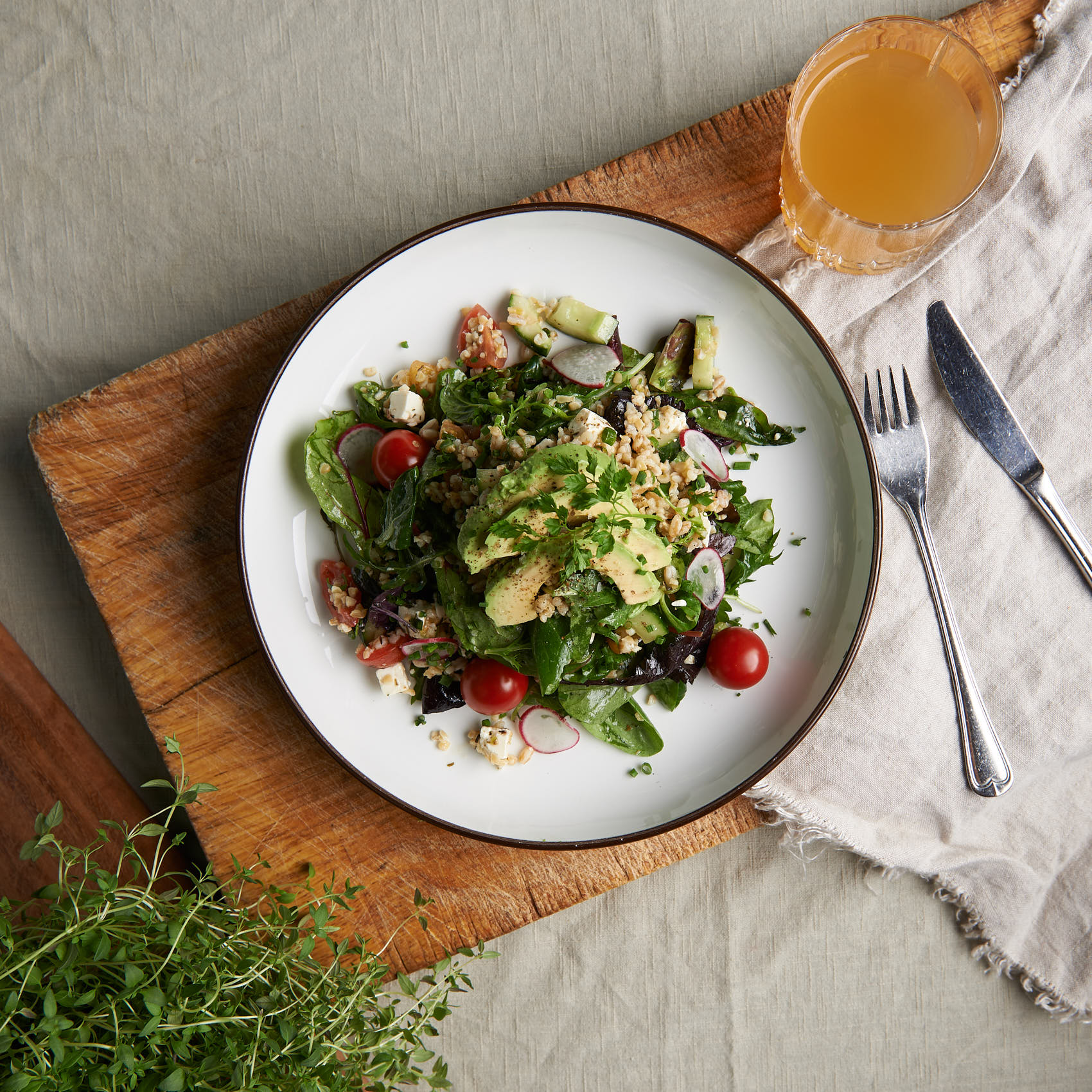 Salad on white linen photo by Marcel Tiedje